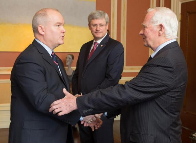 Minister Erin O'Toole being greeted by The Governor General of Canada, His Excellency the Right Honourable David Johnston, with the Prime Minister, the Right Honourable Stephen Harper looking on.
